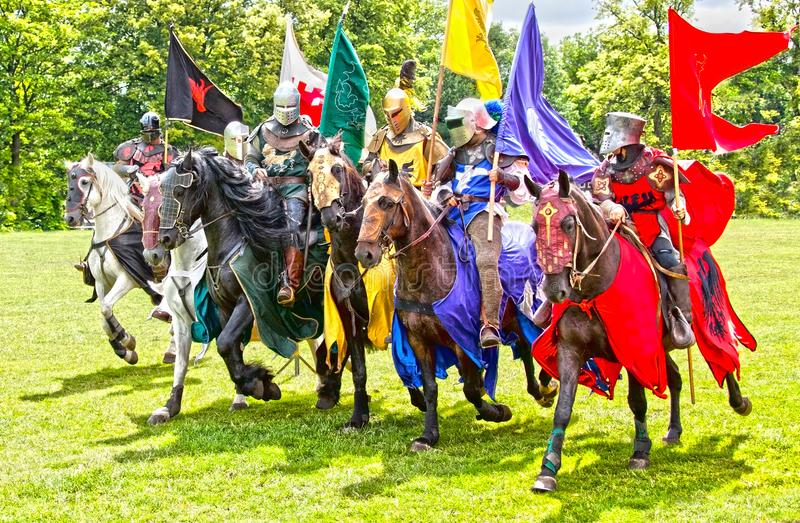 Knights cavalry on horseback medieval times stock photo