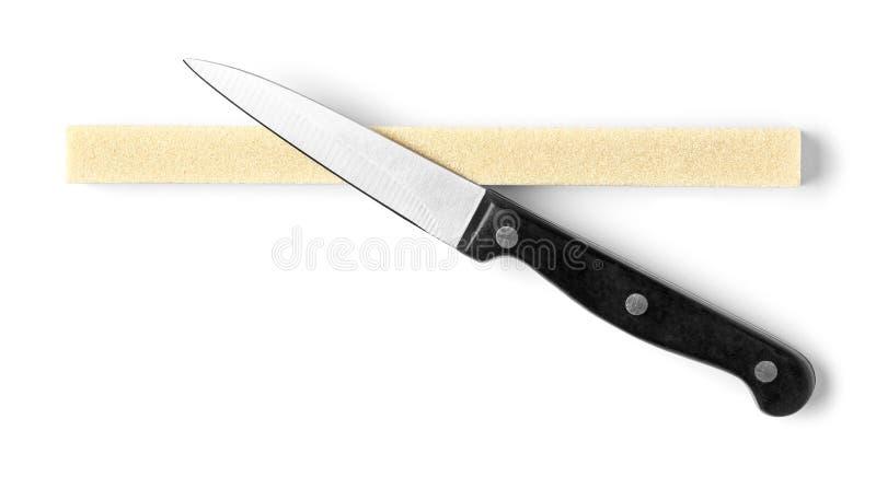 Knippend mes en slijpsteen op wit wordt geïsoleerd dat royalty-vrije stock foto