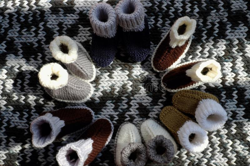 Knit baby booties. For newborn from yarn on woolen blanket, cute handmade products for footwear stock photo