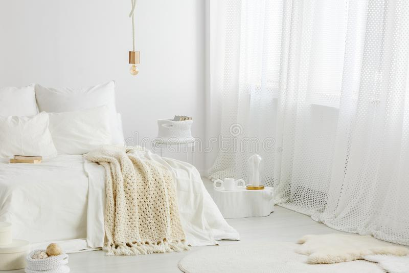 Knit blanket and big window royalty free stock photos