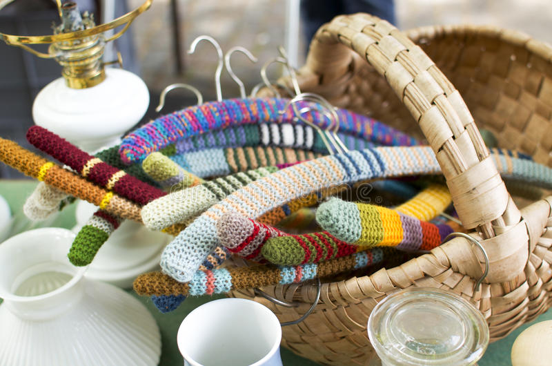 Knit hangers in flea market. Colorful knit hangers in flea market stock photos