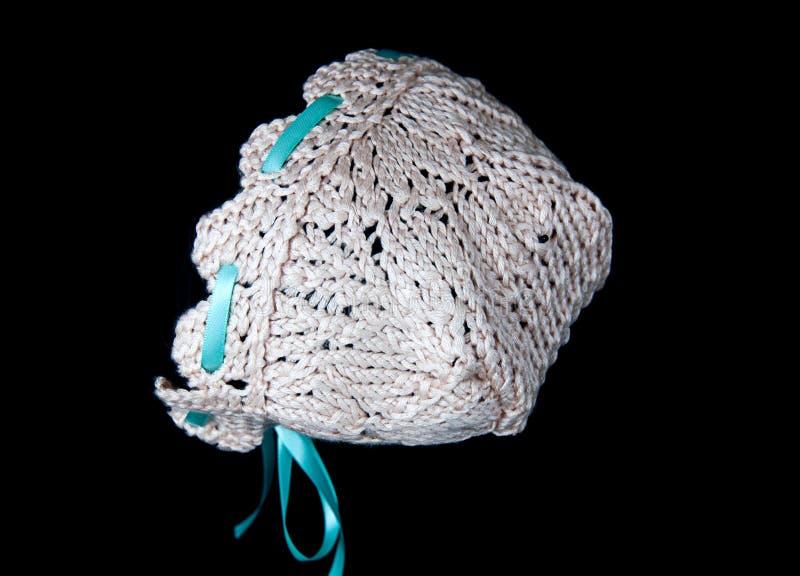 Knit kräppost, babybonnet arkivfoto