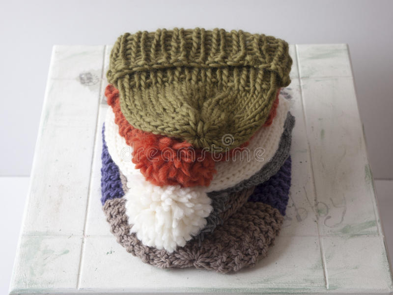 Knit pom pom hats royalty free stock images