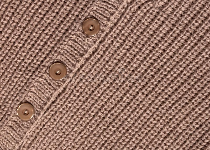 Knit-textur med en knapp royaltyfri fotografi