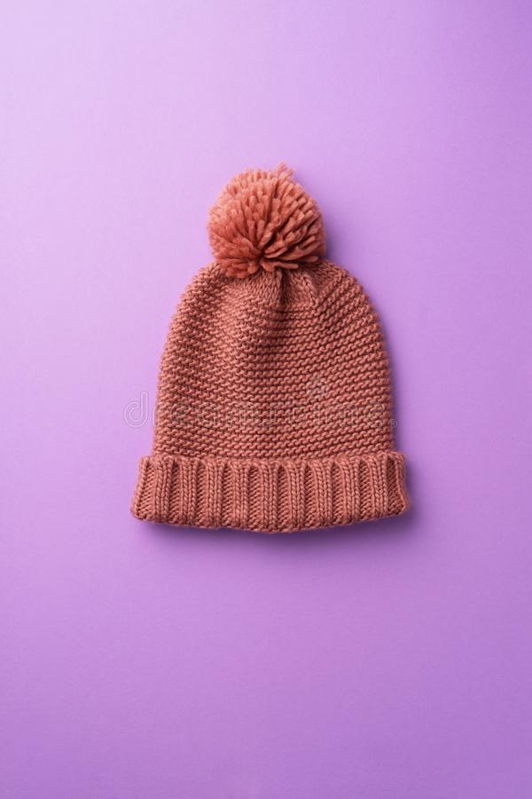 Knit winter hat. Over purple background stock image