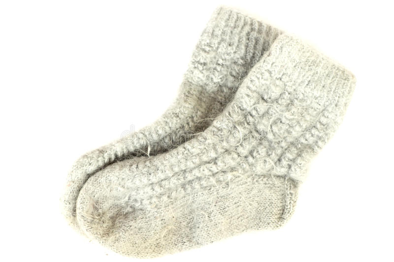 Knit Wool Socks. Pair of gray knit wool socks isolated on white stock images
