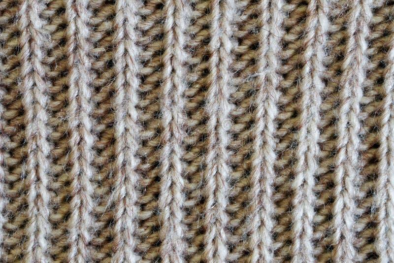 Knit woolen-väv med vertikalt mönster Varmkläder för vinterkall och höstkall Struktur för design eller forskning arkivbild