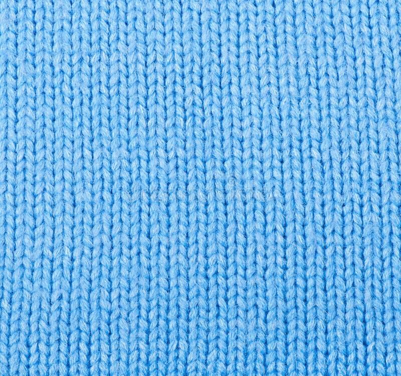 Knit-woolen Weihnachtsfestlicher Hintergrund lizenzfreie stockbilder