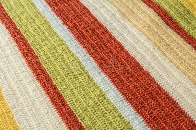 Knitt blanket. Bright warm colored orange and yellow yarn crochet stock photo