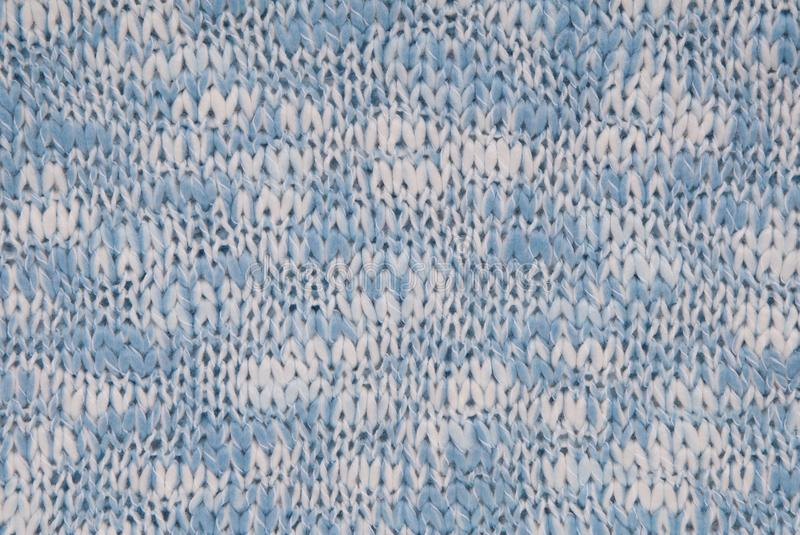 Knitted background, blue and white colour, crocheted backdrop royalty free stock image