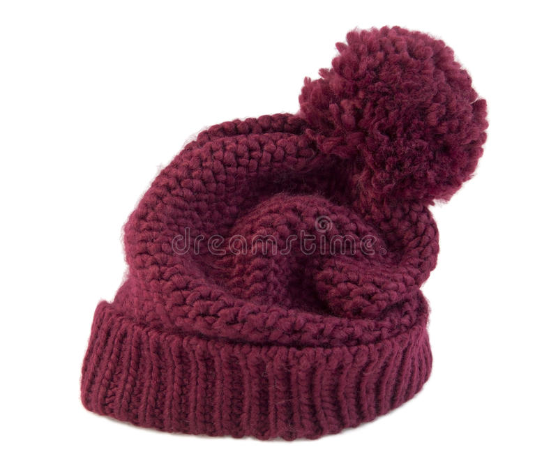 Knitted Beanie. Red wool cap royalty free stock photography