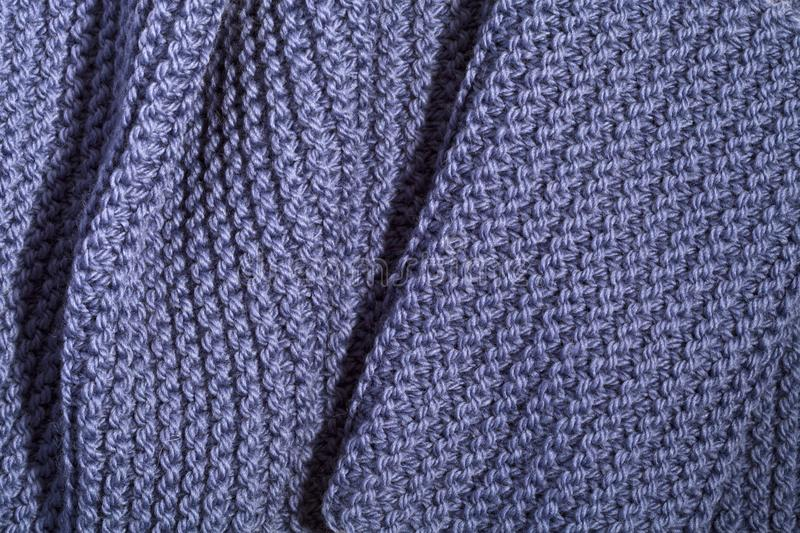 Knitted blue scarf. Close up stock images
