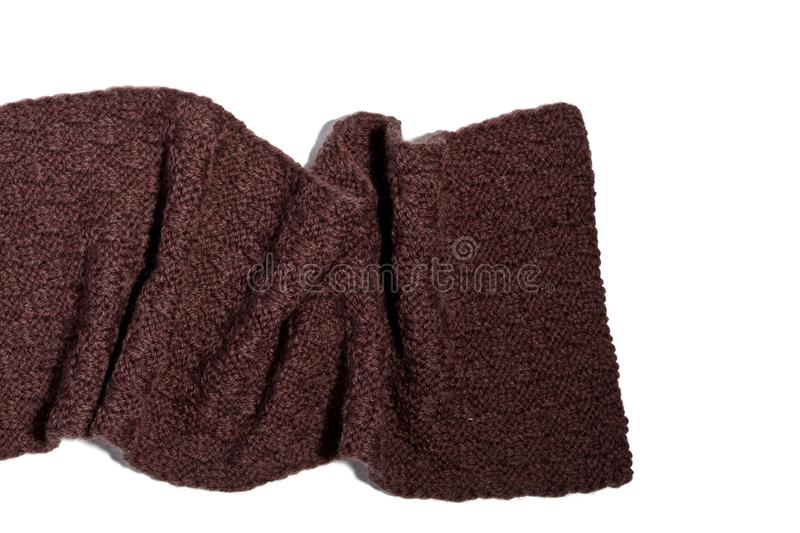 Knitted brown scarf. Isolated on white background stock images