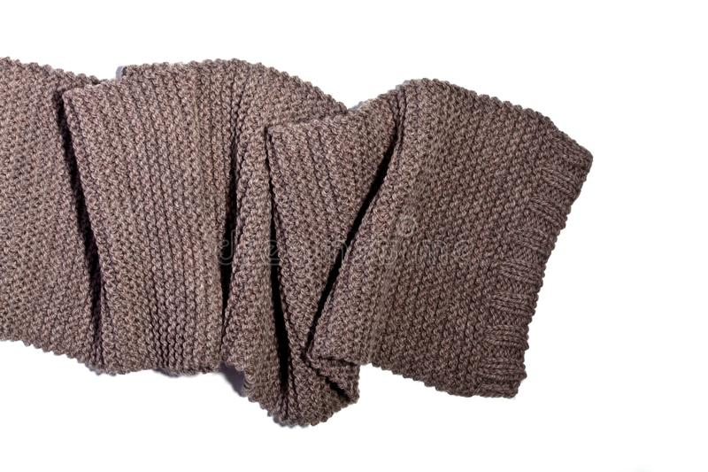 Knitted brown wool scarf. Isolated on white background royalty free stock photos