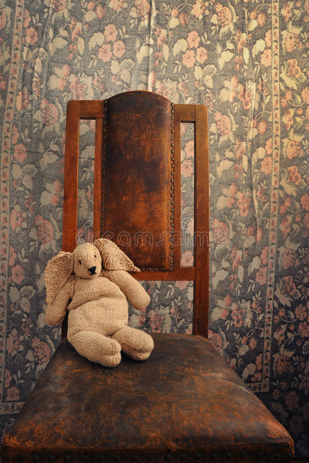 Knitted Bunny Sitting On An Old Chair Royalty Free Stock Photos