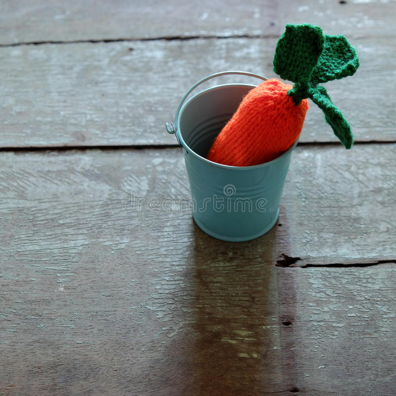 Knitted carrot, funny diy royalty free stock photography