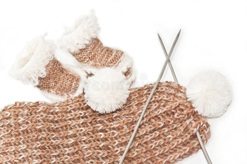 Knitted clothes for infants stock images