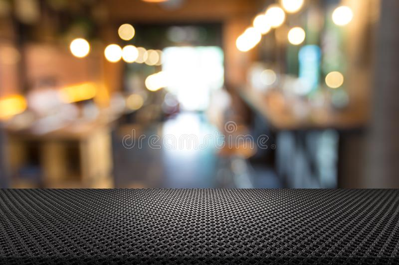 Knitted Cotton Fabric Table with Blur Restaurant Background.  royalty free stock photography