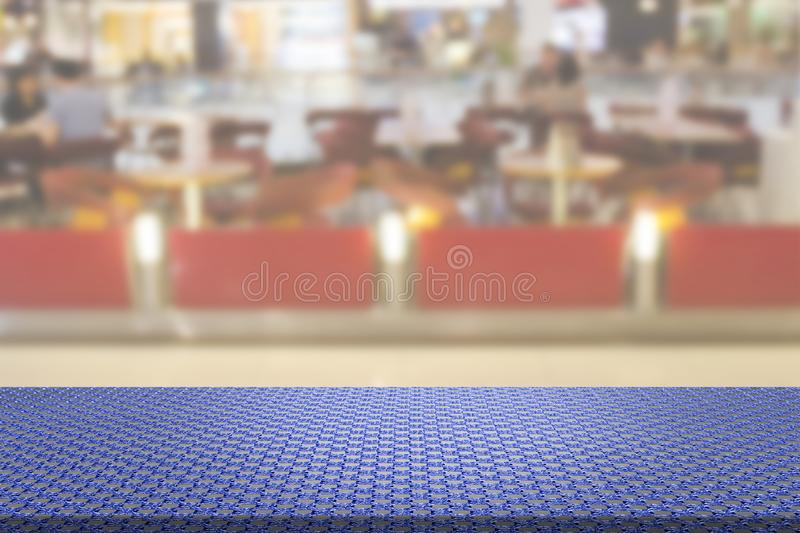 Knitted Cotton Fabric Table with Blur Restaurant Background.  stock photo