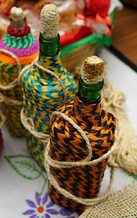 Knitted decorative bottles royalty free stock photo