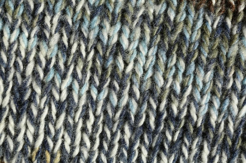 Knitted fabric close-up. Tricot fabric texture and background royalty free stock photos