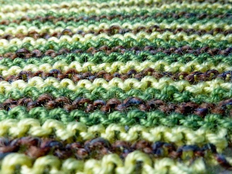 Knitted fabric. Knitting texture. Macro shooting. Background image. Hobbies leisure crafts stock images