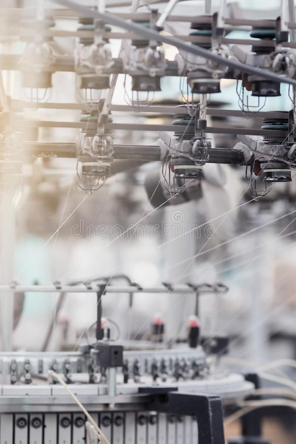 Knitted fabric. Textile factory in spinning production line and a rotating machinery and equipment production company.  royalty free stock photography