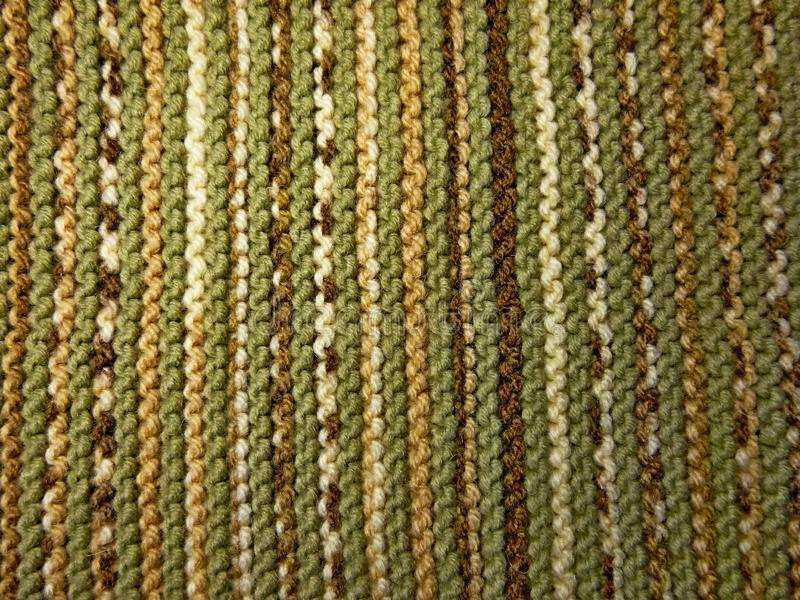 Knitted fabric texture. Background image. Hobbies, leisure, crafts. Green and brown stock photos