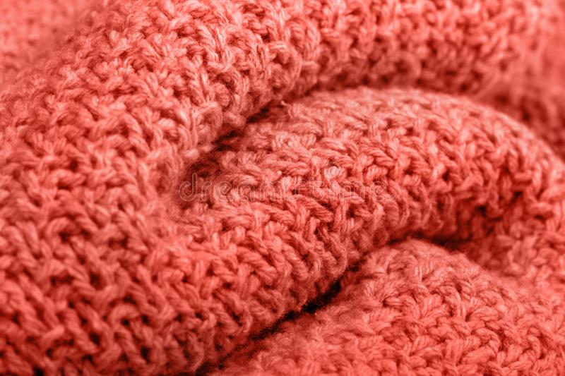 Knitted fabric texture living coral color. stock photos