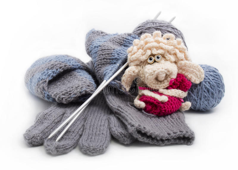 Knitted gloves and scarf in the process of knitting royalty free stock photo