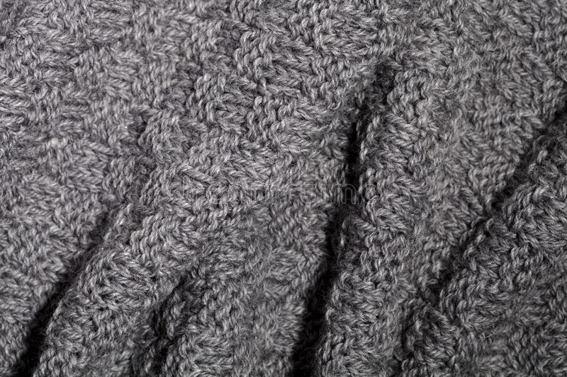 Knitted grey scarf. Close up royalty free stock images
