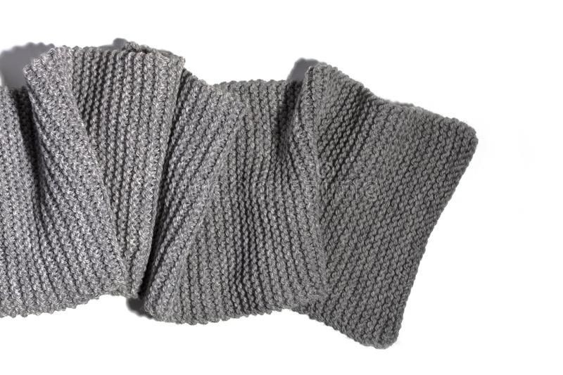 Knitted grey scarf isolated on white background. Knitted wool grey scarf isolated on white background stock image
