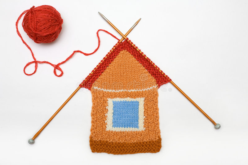 Knitted house on white background. The amusing knitted house against white stock images