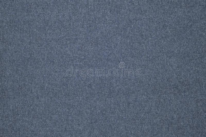 Knitted indigo fabric, jersey cloth backdrop. stock photos