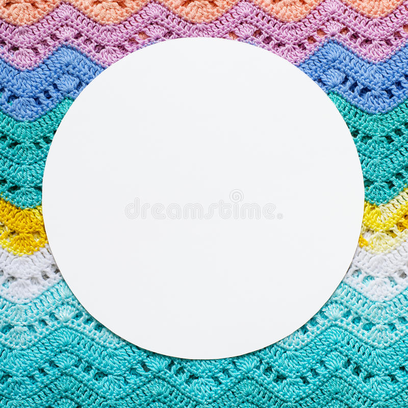 Knitted multicolored cotton canvas In light summer colors. Round royalty free stock photo
