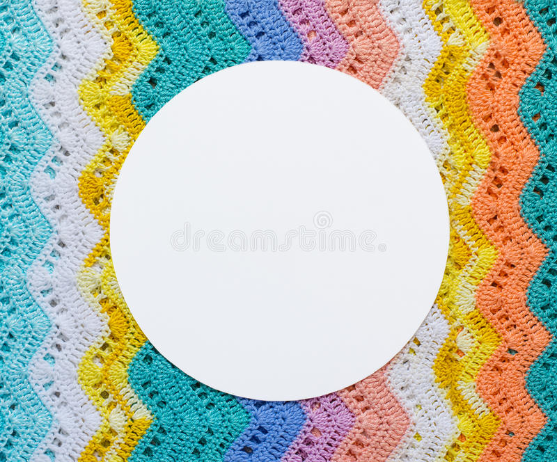 Knitted multicolored cotton canvas In light summer colors. Round royalty free stock images
