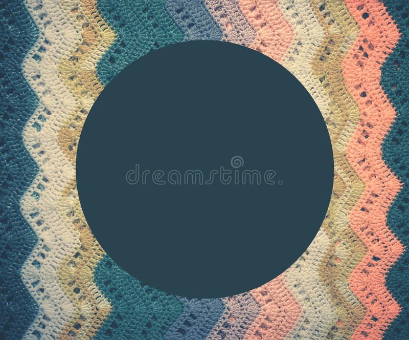 Knitted multicolored cotton fabric In cold blue tones. Round blu royalty free stock photography