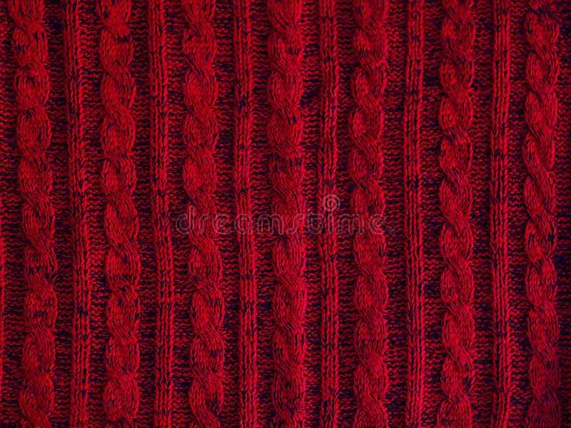 Knitted pattern background, part of red sweater. Knitted pattern background, part of beautiful red sweater. Hobbies. Knitted ornament. Copy space stock photos