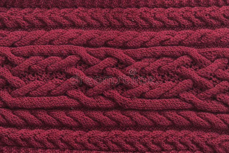 Knitted pattern from wool. Knitted pattern from natural wool. Texture, close-up red stock photography