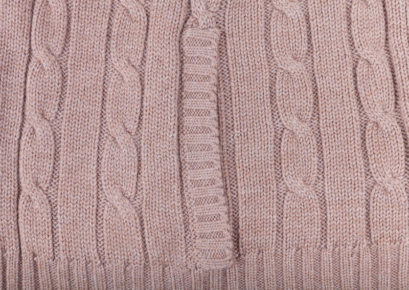 Knitted pattern from woolen warm soft yarn for background.  royalty free stock photography