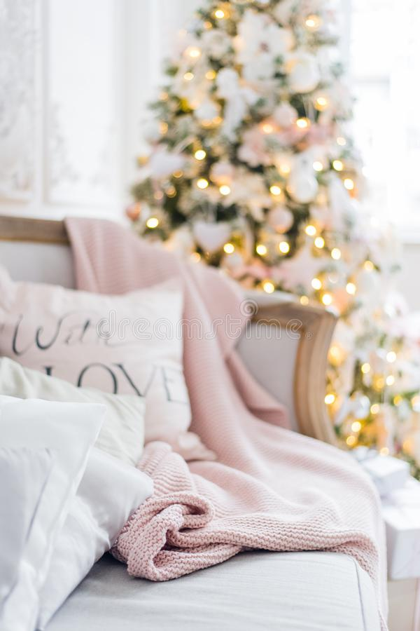 Free Knitted Plaid And Pillows On A Sofa At Home On A Christmas Eve. Home Cosiness Stock Image - 105189201