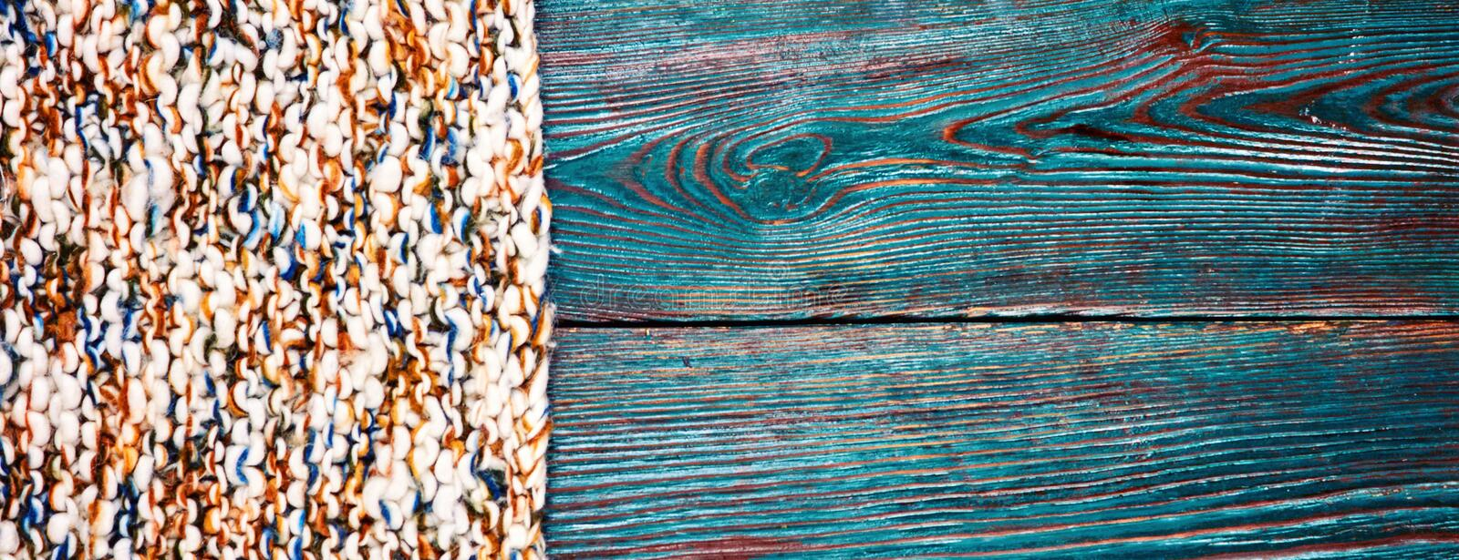 Knitted product carpet plaid close up of fiber of thread texture wool wooden background board floor brown green royalty free stock image
