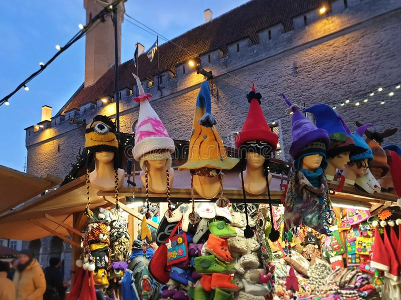 Knitted product made of wool  hat and handmade mittens hats scarves jumpers on   Christmas market place handcraft om Old Town Of T royalty free stock photos