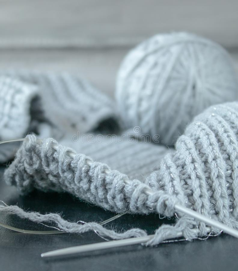 Knitted products on a black background stock photography