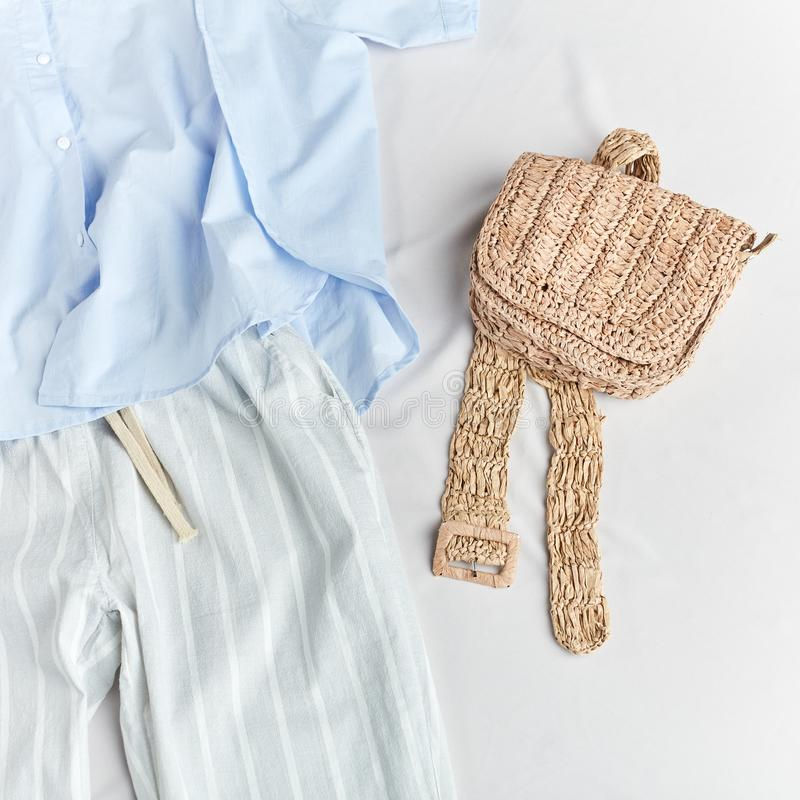 Knitted purse, clutch, wallet aand striped pants and blue blouse stock image