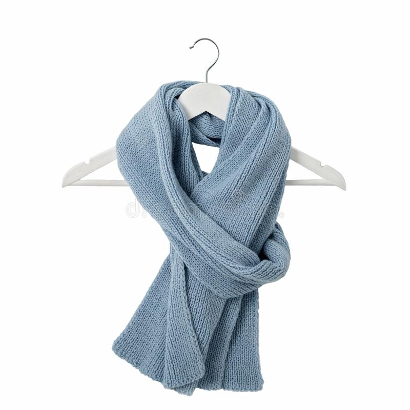 Knitted scarf of blue color on the shoulders on an isolated whit. E background. Flat lay stock images