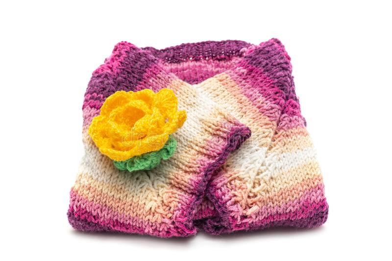 Knitted scarf with flower. Multicolored scarf with knitted flower royalty free stock photography
