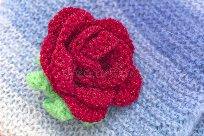 Knitted scarf with flower. Multicolored scarf with knitted flower stock image