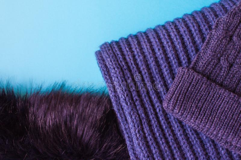 Knitted scarf and hat texture. Purple knitted scarf and hat. Autumn and winter clothes stock images