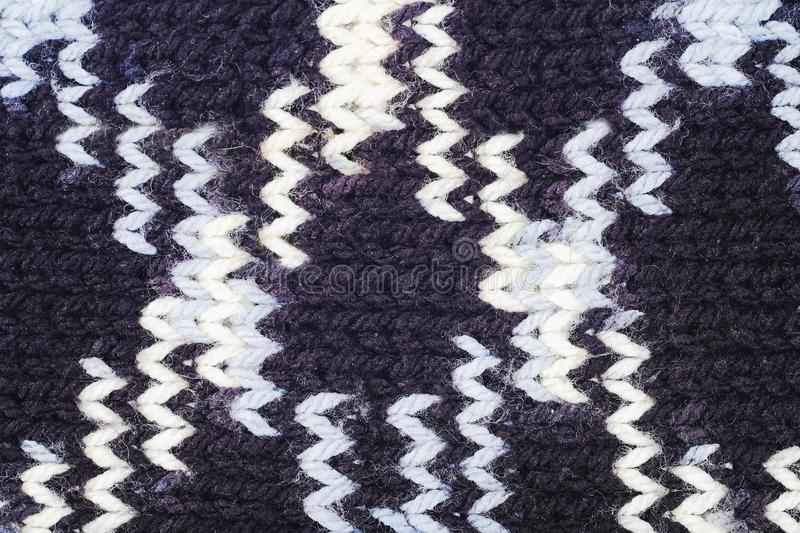 Knitted scarves with white woolen threads. Raster stock photos